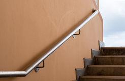 Stainless steel railing. Racetrack, red rubber racetracks in big stadium evening Stock Images
