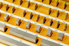 Stainless steel rectangular gauge block metric etalons placed in wooden case. Stainless steel rectangular gauge block metric etalons of various sizes placed in Stock Photos
