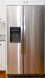 Stainless Steel Refigerator with White Cabinets Royalty Free Stock Photo