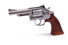 Stainless Steel Revolver. A .357 caliber handgun with a 4 inch barrel isolated on a white background Royalty Free Stock Images