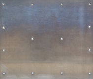 Stainless steel with rivets Royalty Free Stock Images
