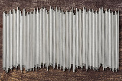 Stainless steel rod. Close up mini stainless steel rod texture on old plank wood background Royalty Free Stock Photos