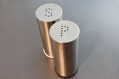 Stainless steel salt and pepper shakers Royalty Free Stock Images