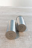Stainless steel salt and pepper shakers Stock Photography