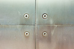 Stainless steel screws and panels Stock Images