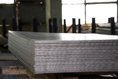 Stainless steel sheets deposited in stacks. Stainless steel bars deposited in stacks in a deposit Stock Photo