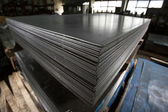 Stainless steel sheets deposited in stacks. Stainless steel bars deposited in stacks in a deposit Stock Photos