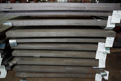 Stainless steel sheets deposited in stacks. Stainless steel bars deposited in stacks in a deposit Stock Photography