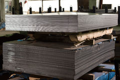 Stainless steel sheets deposited in stacks. Stainless steel construction metal sheets deposited in stacks in a deposit Stock Photos