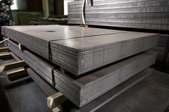 Stainless steel sheets deposited in stacks. Stainless steel construction metal sheets deposited in stacks in a deposit Stock Images