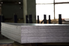 Stainless steel sheets deposited in stacks. In a deposit Stock Photography
