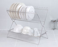 Stainless steel shelf for keeping dishes and cups Royalty Free Stock Image