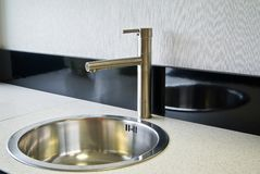 Stainless steel sink Royalty Free Stock Image