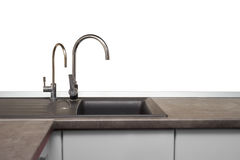 Stainless steel sink and faucet in kitchen room Royalty Free Stock Photography