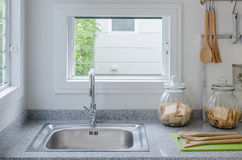 Stainless steel sink in modern kitchen royalty free stock images
