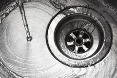 Stainless steel sink plug hole Stock Photo