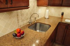 Stainless steel sink in a remodeled kitchen. With a quartz counter Royalty Free Stock Photo