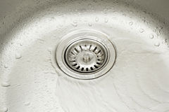 Stainless steel sink with water droplets.  stock photo