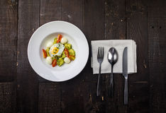 Stainless Steel Spoon Fork and Knife on Top of White Tissue Near White Ceramic Round Plate Stock Image