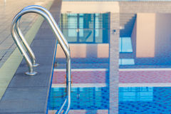 Stainless steel stair in swimming pool Royalty Free Stock Photography