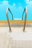 Stainless steel stair to the swimming pool Royalty Free Stock Photos