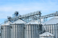 Stainless steel storage silos. Close-up of row of stainless steel storage silos suitable for grain or raw materials Royalty Free Stock Photos