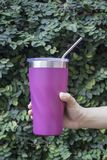 Stainless steel straw and thermos mugs for reusable set. Stock photo Stock Images
