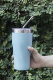 Stainless steel straw and thermos mugs for reusable set. Stock photo Stock Photo