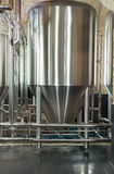Stainless steel tank at the brewery. Royalty Free Stock Photo