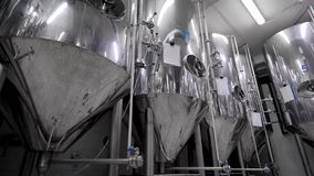 Stainless steel tanks for brewing beer in workshop of modern brewery, automatized process