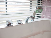 Stainless steel tap and shower head Stock Image