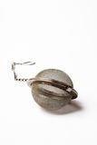 Stainless steel tea ball Royalty Free Stock Photo