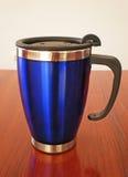 Stainless steel travel mug Stock Photo