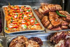 Stainless steel tray with Romanian food box for sale at street food market. Cabbage rolls, spareribs with hot pepper royalty free stock photos