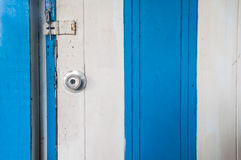 Stainless steel white and blue wood door knob Royalty Free Stock Images