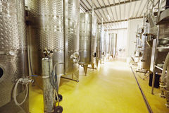 Stainless steel wine fermentation containers in a winery Stock Photo