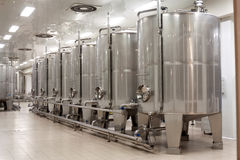 Stainless steel wine reservoirs  in a row Stock Photo