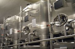 Stainless steel wine tanks. Royalty Free Stock Photos