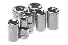 Stainless Steel Wrench Sockets Macro Isolated. Isolated macro image of sockets for socket wrench Royalty Free Stock Images