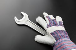 Stainless steel wrench and work glove Stock Images