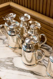 Stainless tea and coffee jugs stock photos