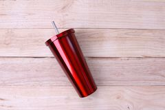 Stainless and tumbler cup  on wooden background Royalty Free Stock Images