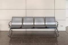 Stainless waiting chair public benches long link row public stool royalty free stock photos