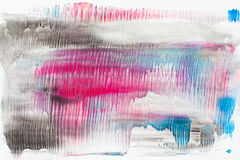 Stains of black, pink and blue paint on white royalty free stock photography