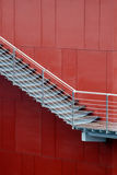 Stair. And a red wall Stock Photography