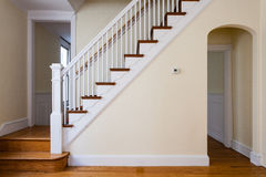 Stair and Arch in Home. Pretty woodowrk and unusual arched passageway design in an elegant 1920s American townhome Royalty Free Stock Photography