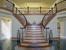 Stair Case Foyer. The entrance to this beautiful house, the spiral stair case Stock Image