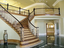 Stair Case Foyer. The entrance to this beautiful house, the spiral stair case the grand entrance Stock Images