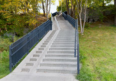 Stair case with railings in autumn park Royalty Free Stock Photography