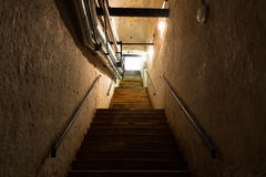 Stair in the cellar, an old industrial building Stock Images